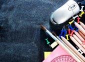 Fotografie school supplies and blackboard