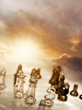 Game of chess pieces in front of bright sky stock vector
