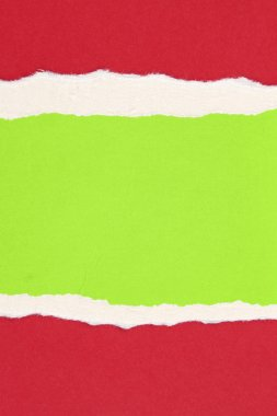 Ripped red and green paper