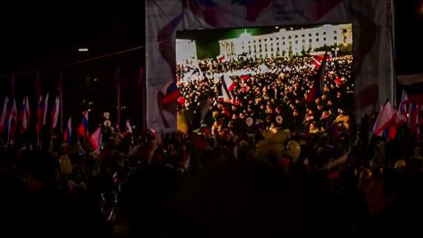 Huge Crowd Watching Concert On Big Screen