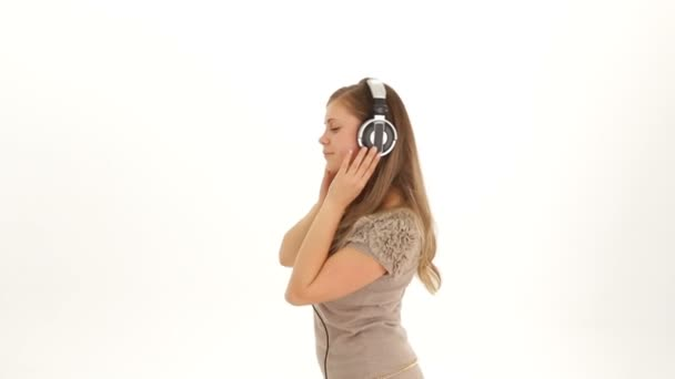 Young Pretty Girl In Earphones Listening to Music And Dancing