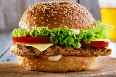 Burger with grilled chicken and cheese