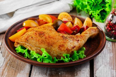 Baked chicken leg with tomatoes