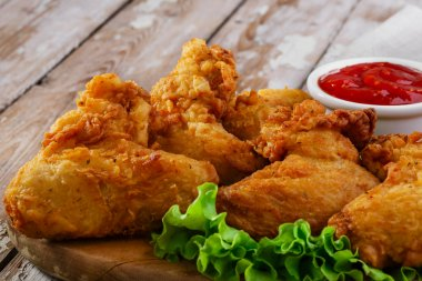 Fried chicken wings in batter