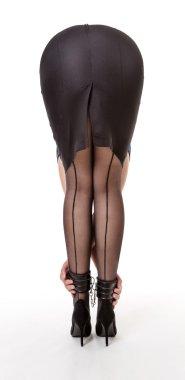 Girl in black skirt bends forward