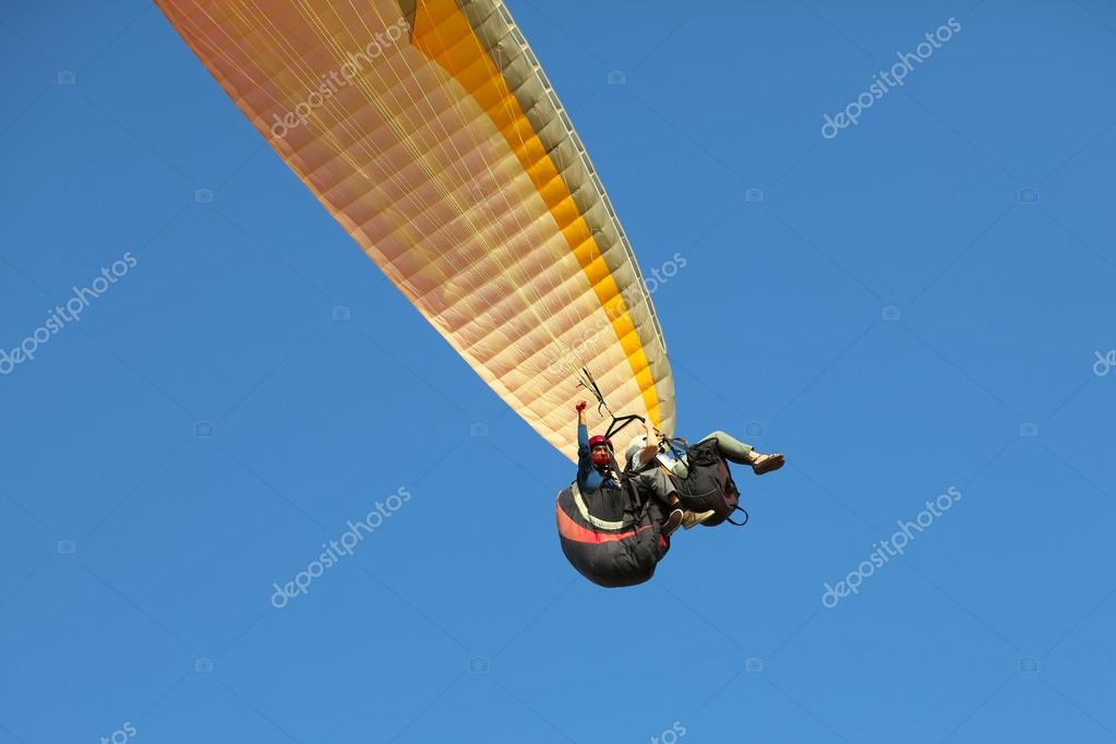 man and woman paragliding