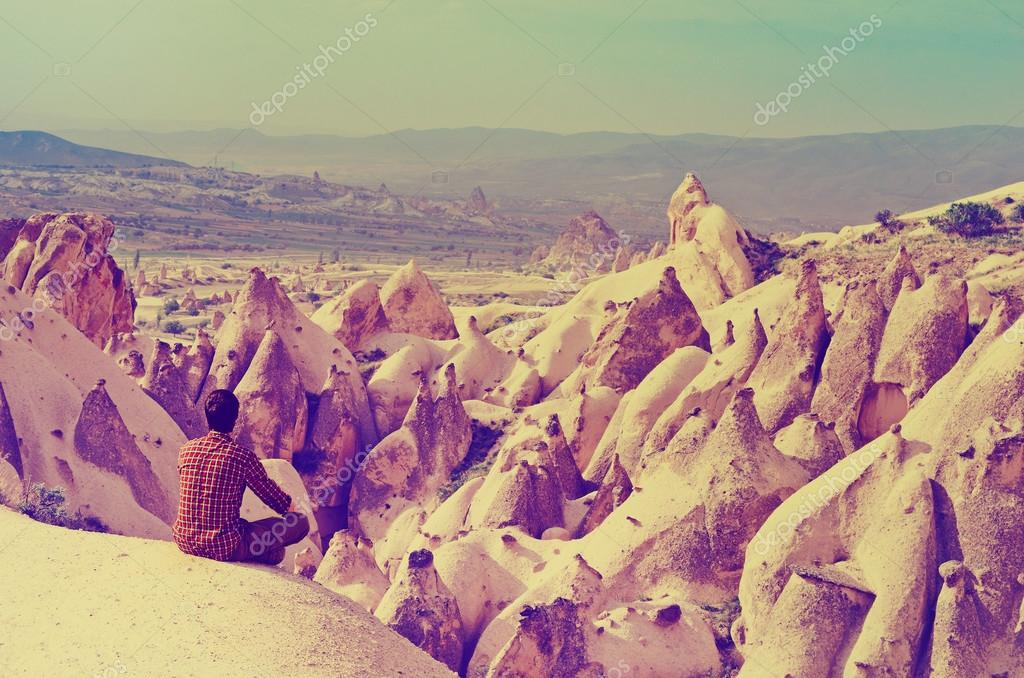 Traveler in mountains, Cappadocia, Turkey