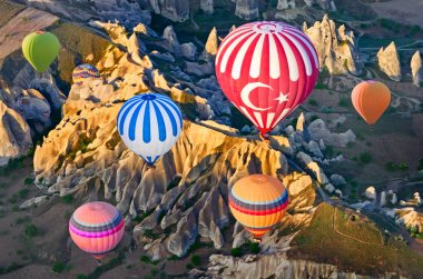 Hot air balloons over mountain landscape