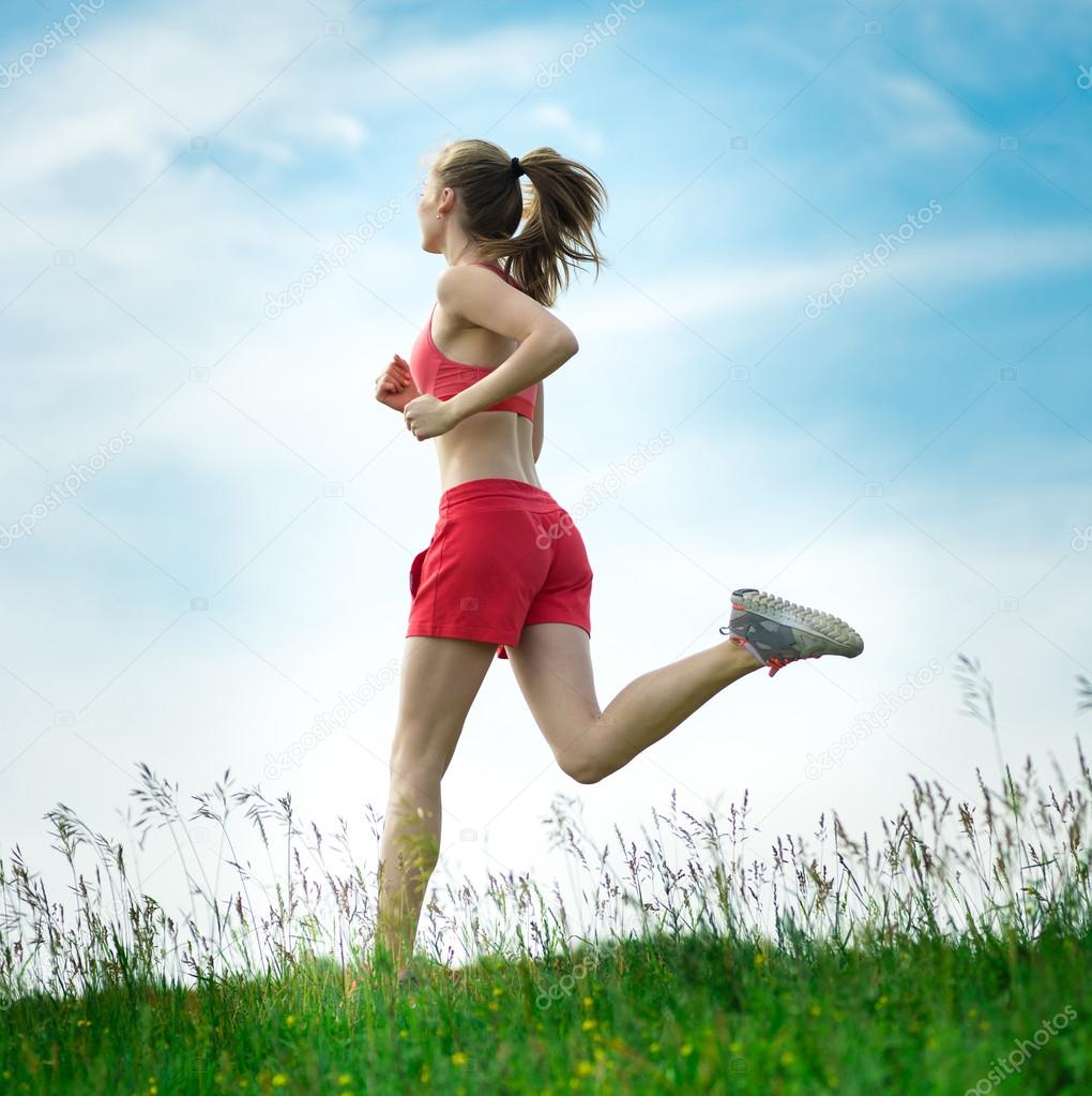 Young woman running summer park rural road  Outdoor