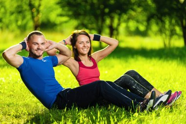 Couple exercising at the city park. Outdoor sport