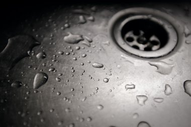 water drop in a dirty sink close up