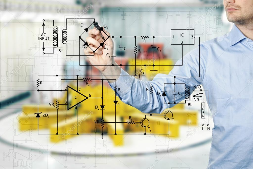 electrical engineer draws a diagram of a circuit. power plant in