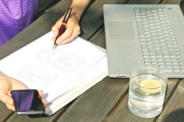 freelance designer drawing mobile application wireframe