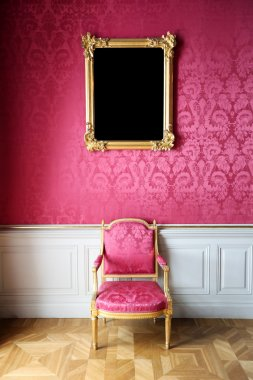 vintage style interior with chair and blank picture on the wall
