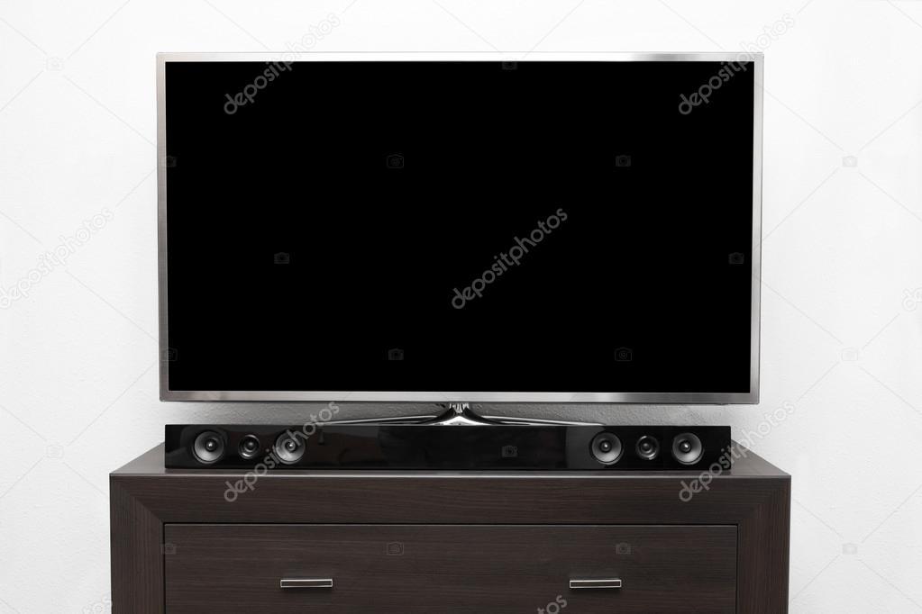 Grosser Tv Mit Leeren Bildschirm Auf Braun Kommode Auf Weisse Wand