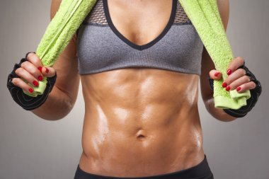 Fit woman with a green towel