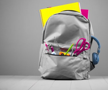 School backpack on grey background