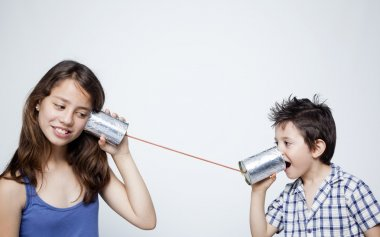 Kids using a can as telephone