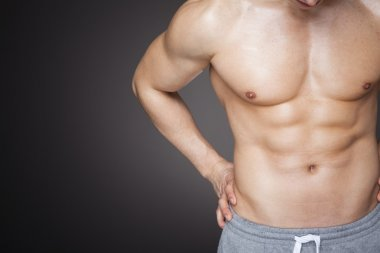 Fit man showing six pack abs