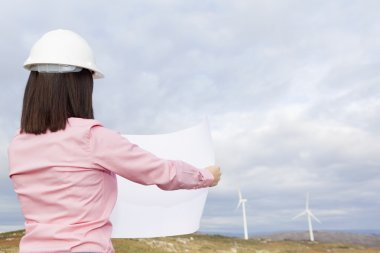 Female engineer holding a plan