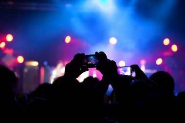 People at rock concert taking photos