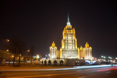 Illuminated Royal Hotel Radisson (Hotel Ukraina) near river at n