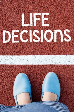 Female legs with life decisions text