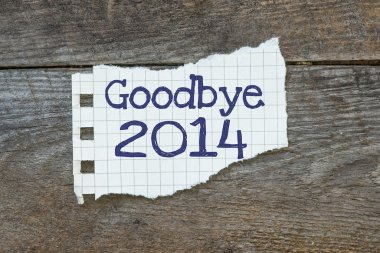 Goodbye 2014 written on the paper