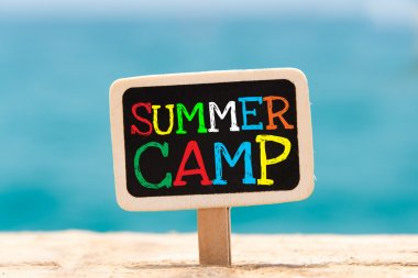 Text Summer camp written with chalk on chalkboard