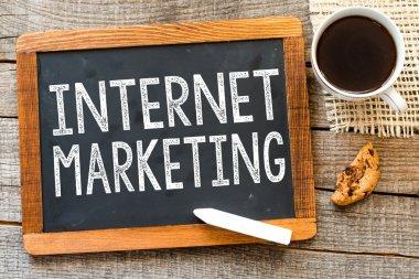 Internet marketing handwritten with white chalk