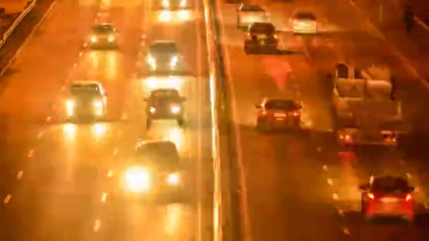 time lapse of cars moving by the night road