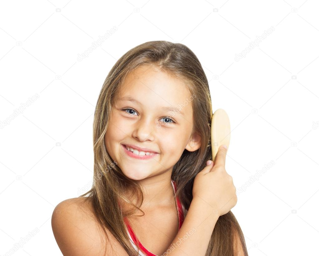 Beautiful little girl combing her long hair comb on a white back beautiful little girl combing her long hair comb on a white back stock photo urmus Choice Image