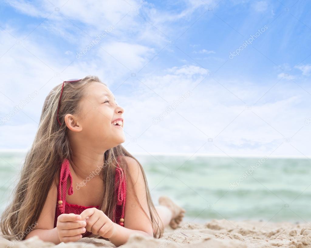 Beautiful Little Girl Lying On The Sandy Sea Beach  Stock Photo  Gurinaleksandr -4422