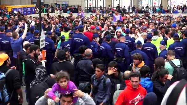 BUDAPEST, HUNGARY - AUTUMN 2015: Immigrants and refugees at the railway station in Budapest. People in Syria and the Middle East. Shot in 4K, UHD