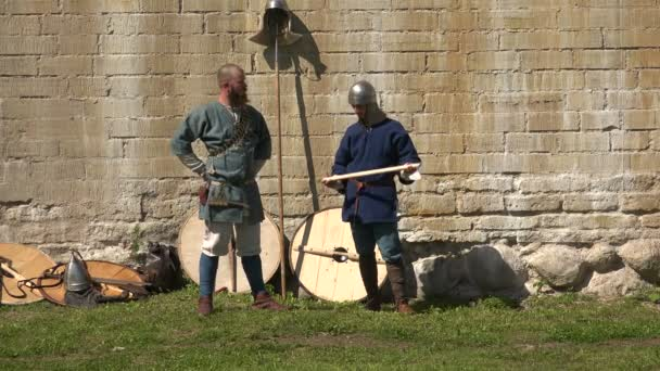 The camp of the Vikings. The Vikings before the battle. Medieval warriors. Video in 4K, UHD. Real time.