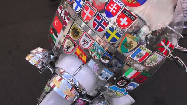 Wind shield with labels in different countries. 4K.