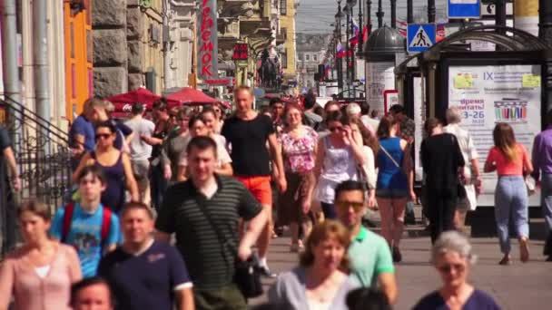 Nevsky prospect. Saint-Petersburg. People go along the Avenue. Slowmotion. 4K.