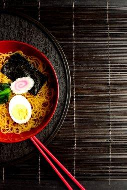 Ramen noodles with red chopsticks