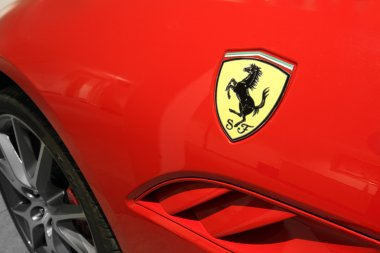 Ferrari Horse Logo Close Up on Red Car