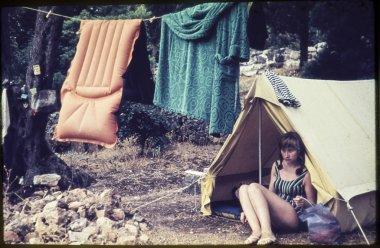 original vintage colour slide from 1960s, young woman sitting in her tent.