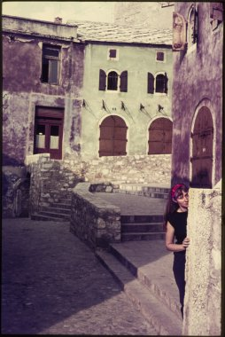 original vintage colour slide from 1960s, woman posing in street on vacation.