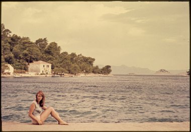 original vintage colour slide from 1960s, young woman by sea side.