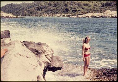 original vintage  colour slide from 1960s, young woman standing near sea.