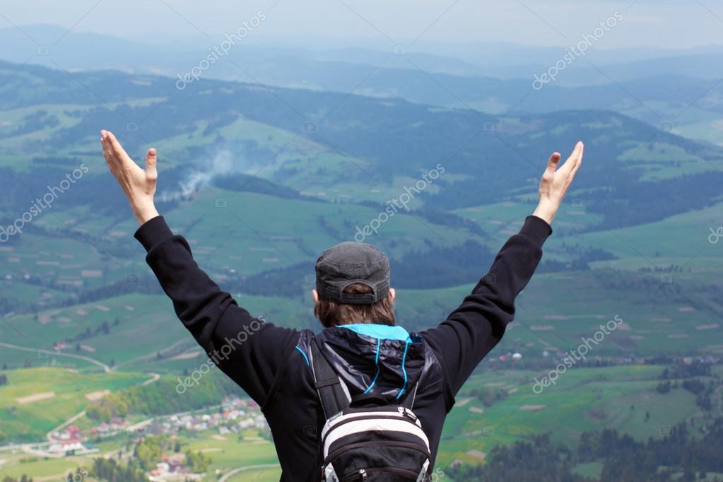 free man open arms to mountains