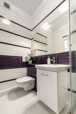 Modern bathroom in white and violet style