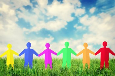 Concept of unity and friendship. Many multicolored paper people characters stand together