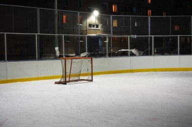 Empty hockey gate on an ice rink in the evening