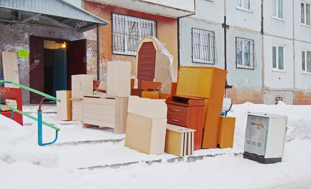 Flat moving. Furniture stands near the entrance of the house