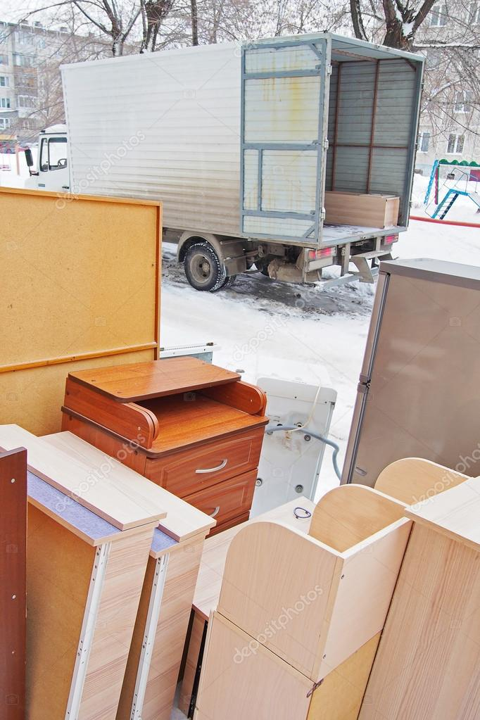 Flat moving. Furniture stands outdoor near the truck