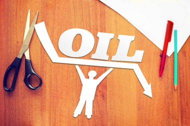 Abstract man keeps oil prices against falling. Concept of declining oil prices